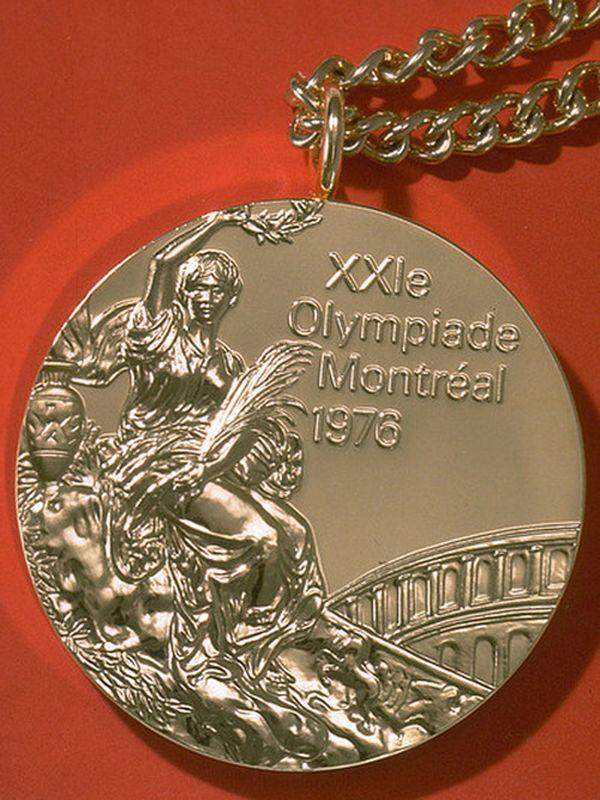 Золотая медаль XXI Летних Олимпийских игр. Дизайнер: Джузеппе Кассиоли